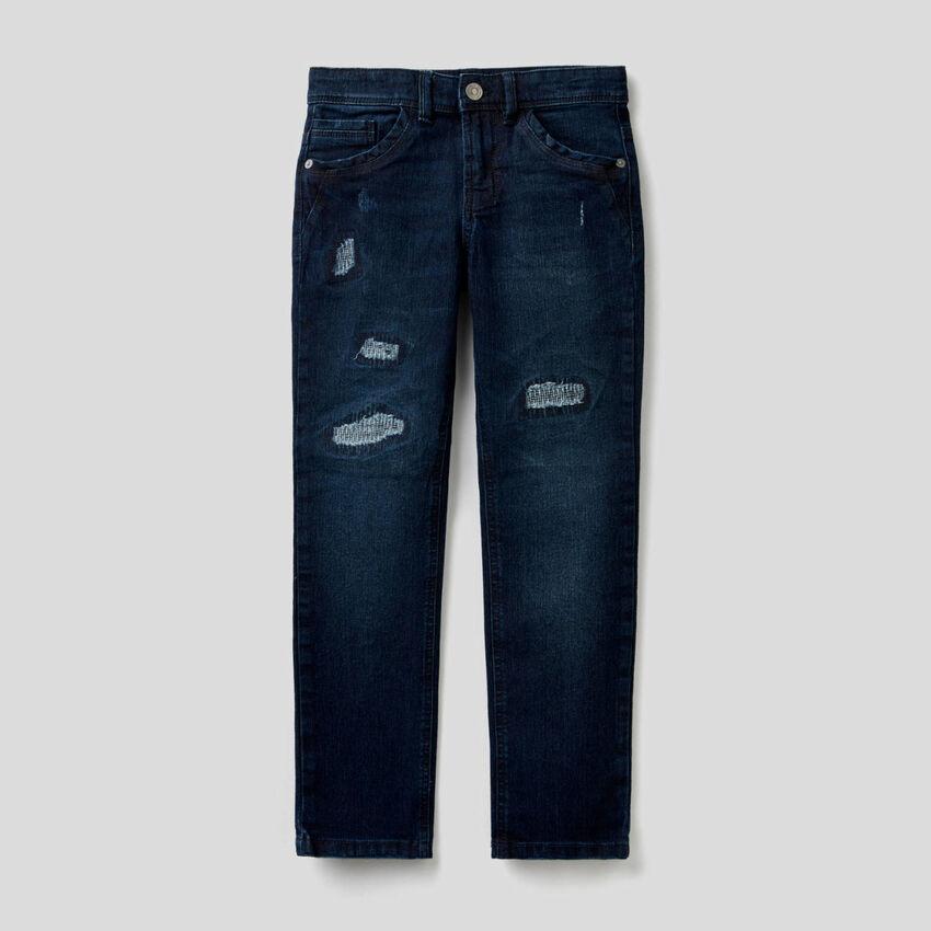 Jeans coupe slim avec aspect usé