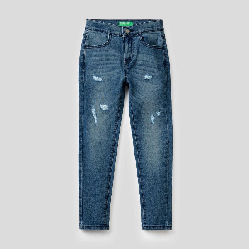 Jeans skinny con aspetto vissuto