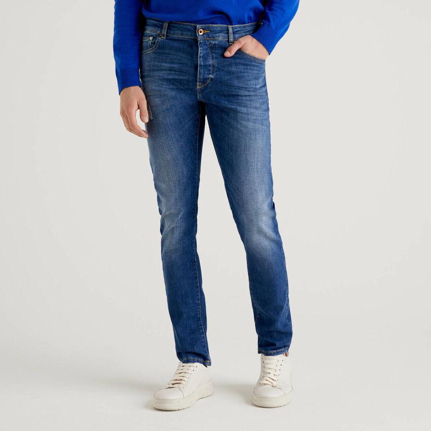 Jeans cinque tasche effetto vissuto