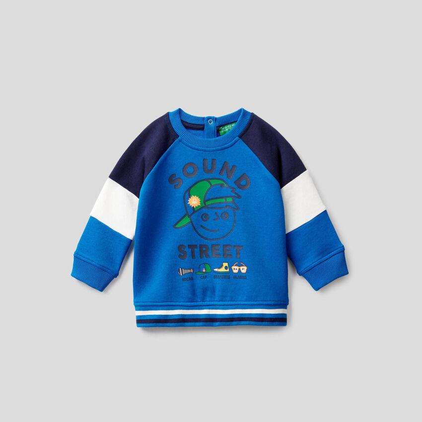 Cornflower blue sweatshirt with color block sleeves