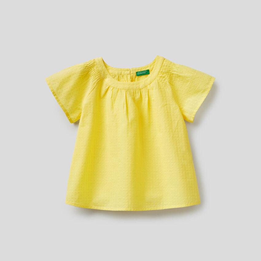 Blusa ricamata in 100% cotone