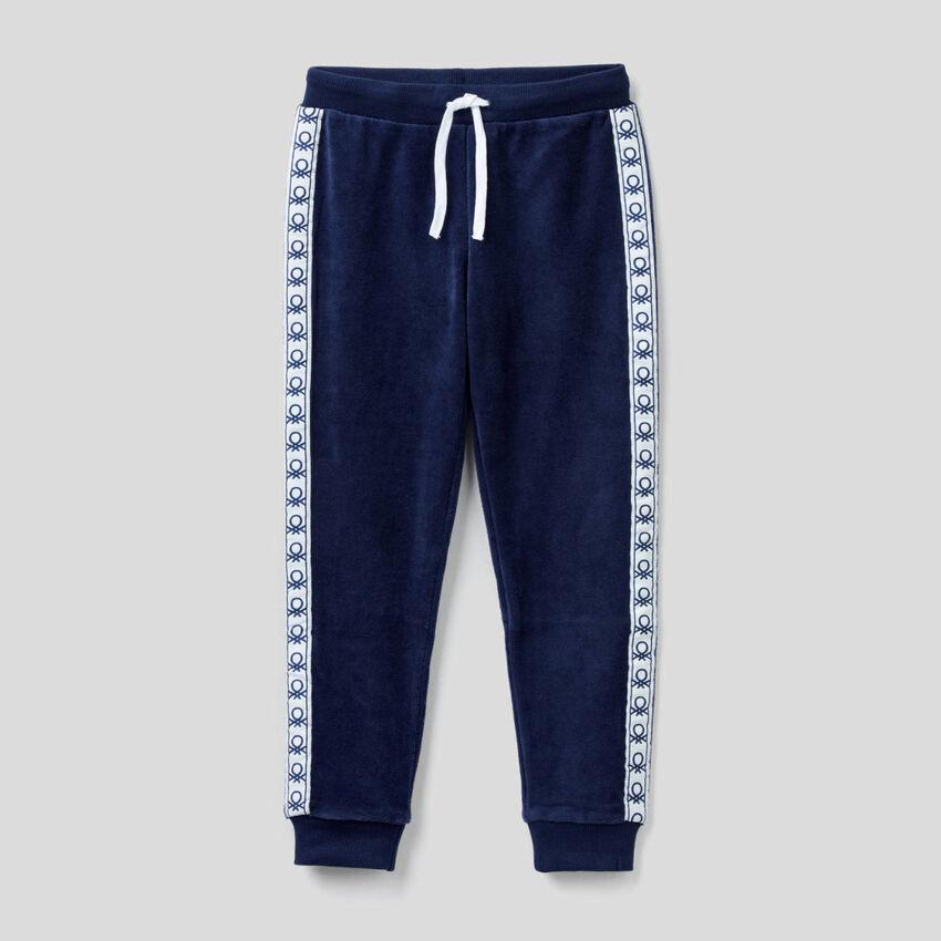 Pantaloni in ciniglia con bande logate