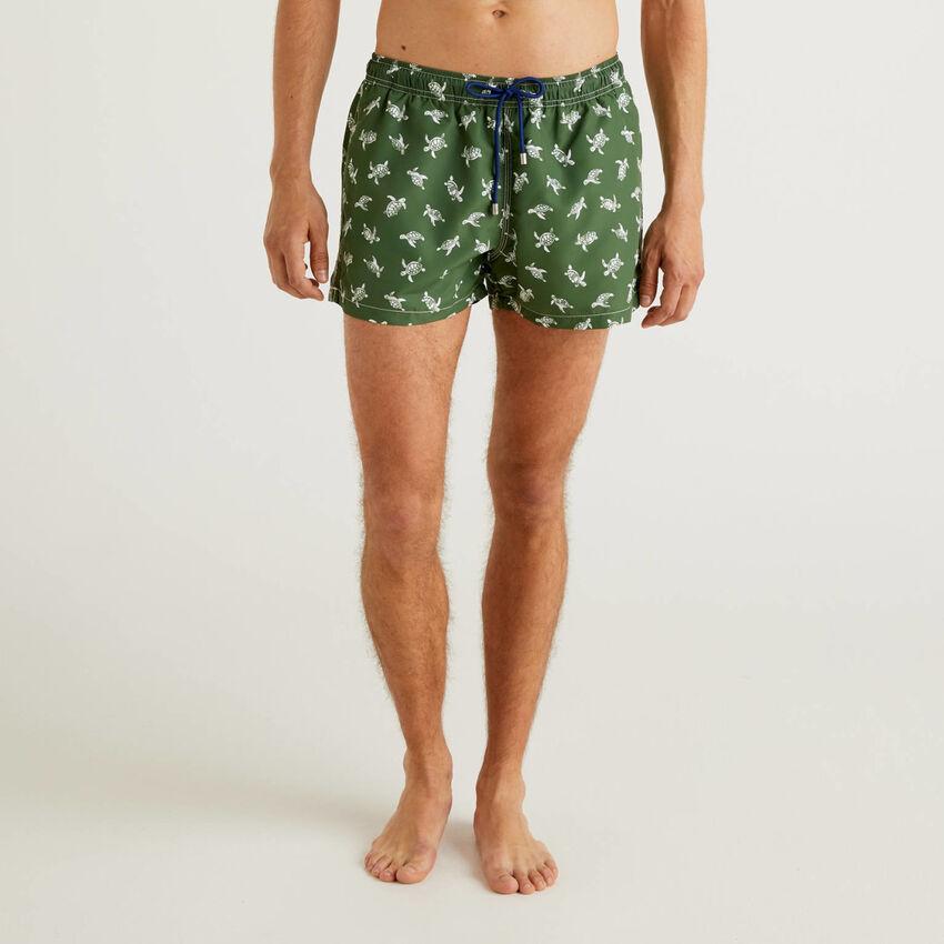 Short patterned swim trunks